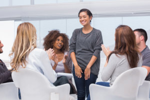 woman sharing in a support group